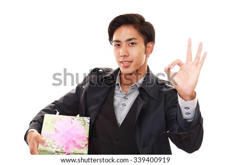 Smiling man with a gift - stock photo