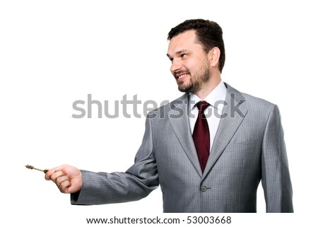 Smiling man with a key on a hand - stock photo