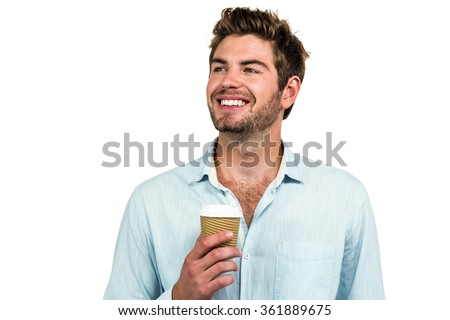 Smiling man with disposable cup on white screen - stock photo