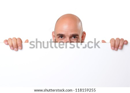 smiling man with empty advertising board - stock photo