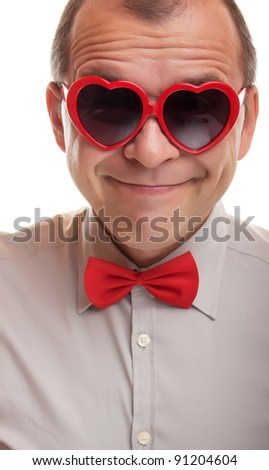 Smiling man with heart shaped sunglasses isolated on white background - stock photo