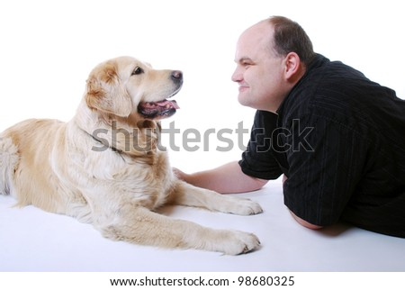 smiling man with his golden retriever