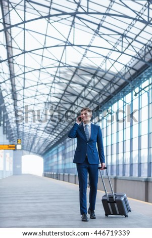 Smiling man with luggage at station