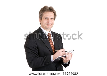 smiling man with pen and notebook - stock photo