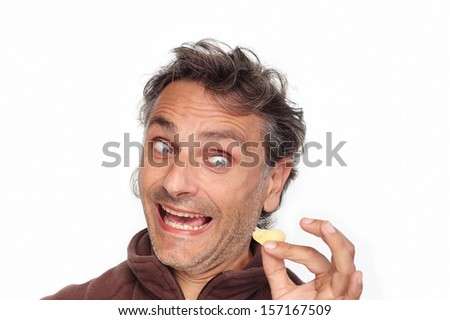 smiling man with potato chips over white