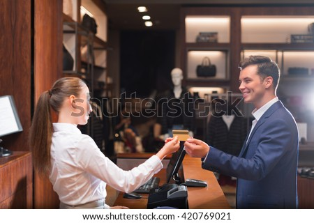 Smiling man with seller in store - stock photo