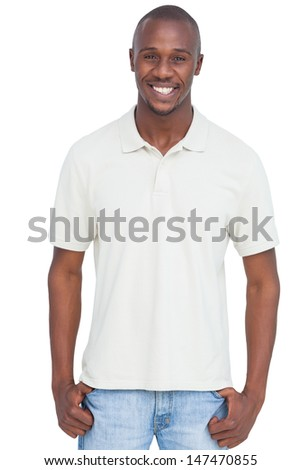 Smiling man with thumbs in pocket on a white background - stock photo