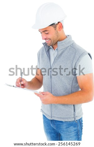Smiling manual worker writing on clipboard on white background - stock photo