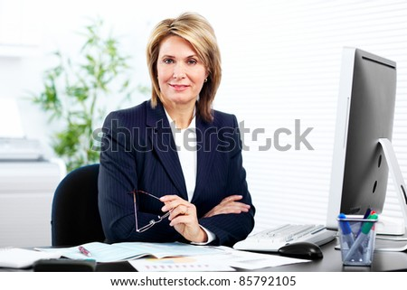 Smiling mature business woman. In a modern office. - stock photo