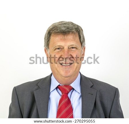 smiling mature businessman with tie and suit - stock photo
