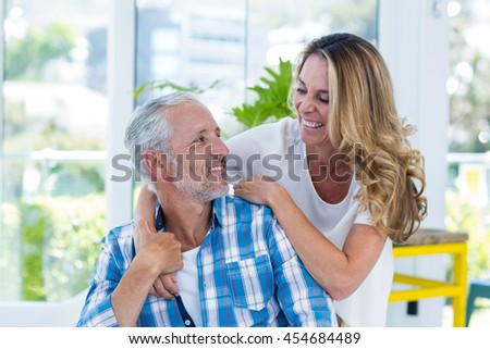 Smiling mature couple in restaurant