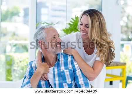 Smiling mature couple in restaurant - stock photo
