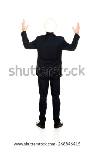Smiling mature engineer with open arms up. - stock photo