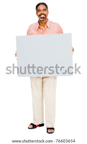Smiling mature man showing a placard isolated over white - stock photo