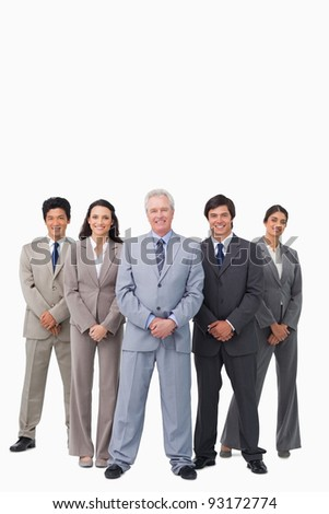 Smiling mature salesman standing together with his team against a white background