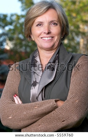 Smiling mature woman looking at camera. - stock photo
