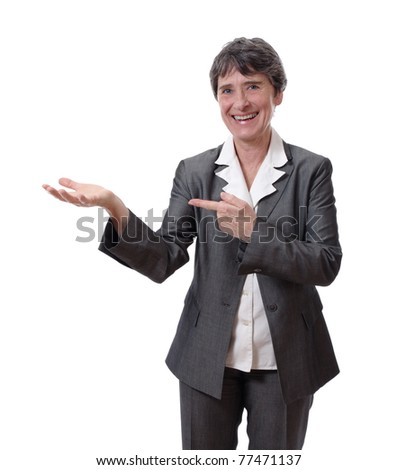 smiling mature woman showing empty hand isolated on white background - stock photo