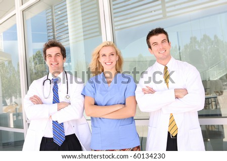 Smiling medical doctor and nurse with stethoscope at the hospital - stock photo