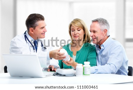 Smiling medical doctor and patient. Health care. - stock photo