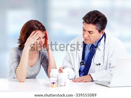 Smiling medical doctor with patient woman  in hospital.