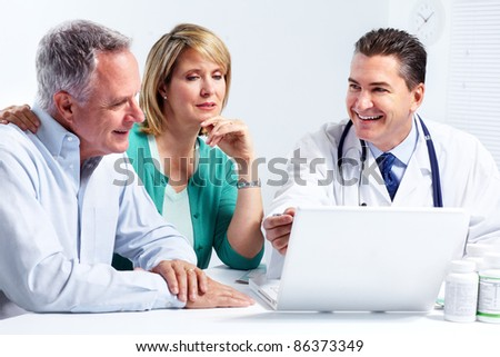 Smiling medical doctor with senior couple. Health care. - stock photo