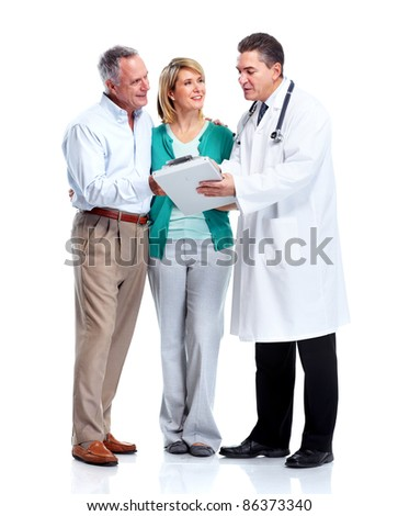 Smiling medical doctor with senior couple. Isolated over white background. - stock photo