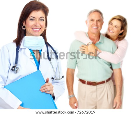 Smiling medical doctor with stethoscope and elderly couple - stock photo