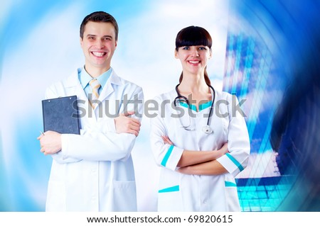 Smiling medical doctor with stethoscope on the hospitals background - stock photo