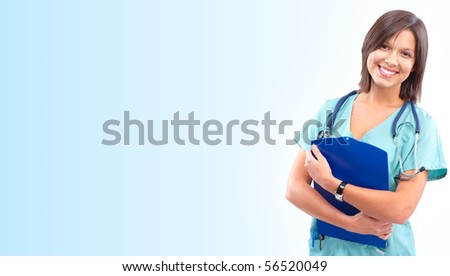 Smiling medical doctor with stethoscope. Over blue background - stock photo