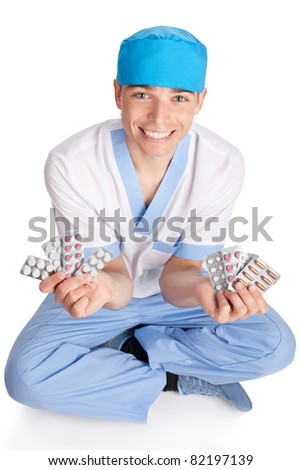 smiling medical doctor with tablets in hands isolated on white background