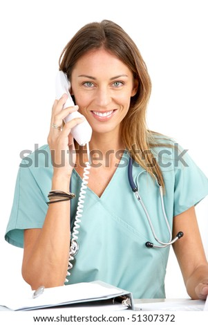 Smiling medical doctor with telephone. Over white background - stock photo