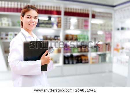 Smiling medical doctor woman asia with stethoscope and clipboard checking medicine cabinet . - stock photo