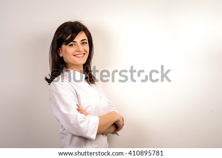 Smiling medical doctor woman.  Pretty girl in uniform - stock photo