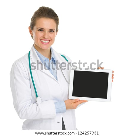 Smiling medical doctor woman showing tablet PC with blank screen