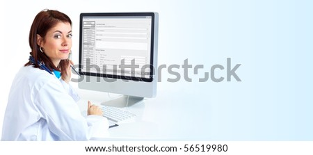 Smiling medical doctor woman with computer. Over blue background - stock photo