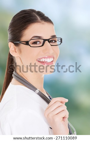 Smiling medical doctor woman with stethoscope. - stock photo