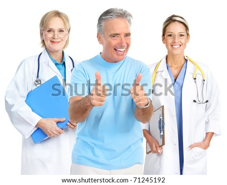 Smiling medical doctors and a smiling elderly man - stock photo