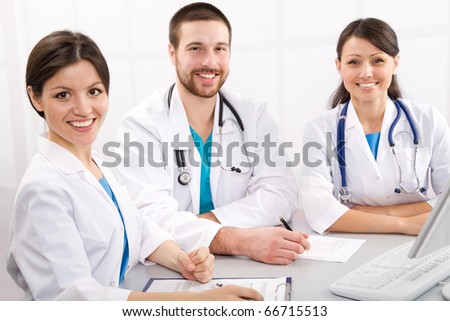 Smiling medical doctors on a workplace