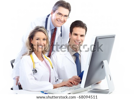 Smiling medical doctors working with a computer. Isolated over white background - stock photo