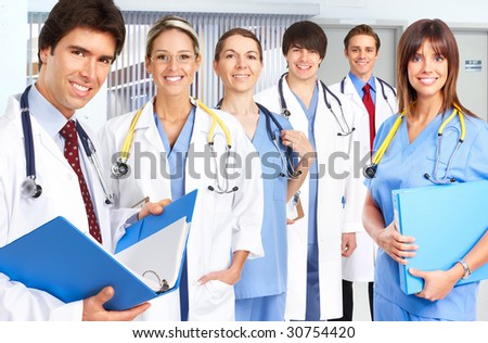 Smiling medical people with stethoscopes. Doctors and nurses