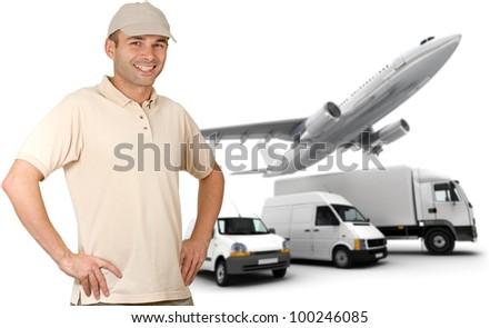 Smiling messenger against a transportation fleet - stock photo