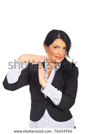 Smiling mid adult busienss woman gesturing time out isolated on white background - stock photo