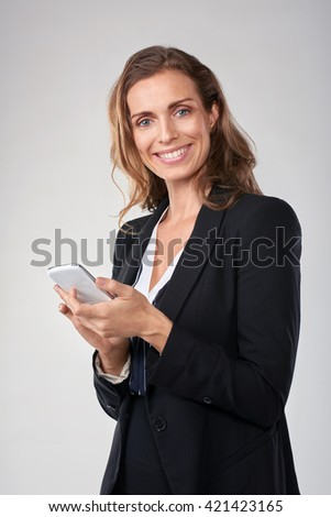 Smiling middle age business woman holding mobile cell phone smartphone - stock photo
