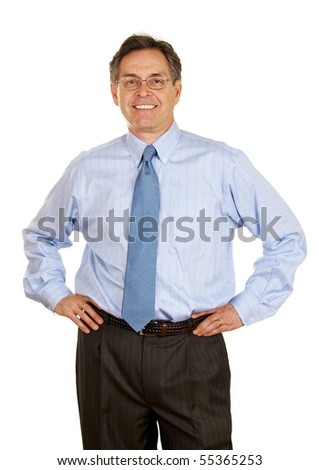 Smiling middle age businessman with hands on hips - stock photo