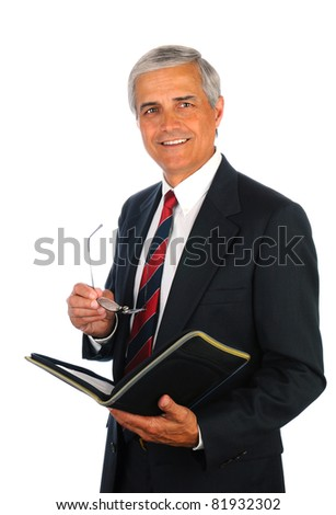 Smiling middle aged businessman holding a binder and his eye glasses while standing isolated on white.
