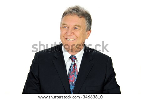 Smiling middle aged businessman looking away from camera.