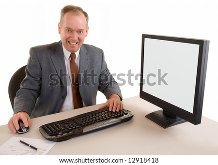 Smiling Middle Aged Businessman Sitting at his Desk. - stock photo