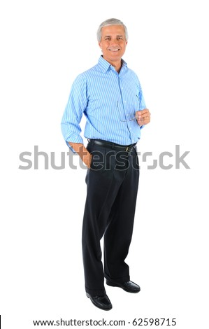 Smiling middle aged businessman standing with one hand in his pocket and the other holding his eye glasses. Business man is in full  length over a white background. - stock photo