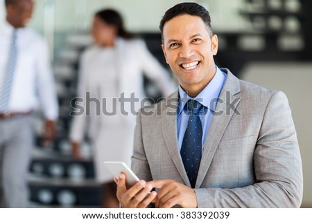 smiling middle aged businessman using smart phone