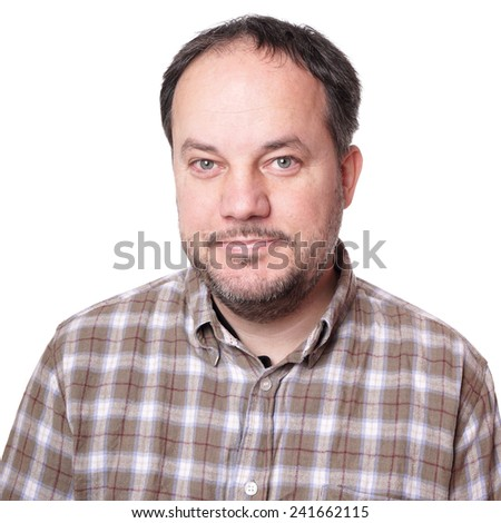 smiling middle aged man wearing checkered shirt and beard - stock photo